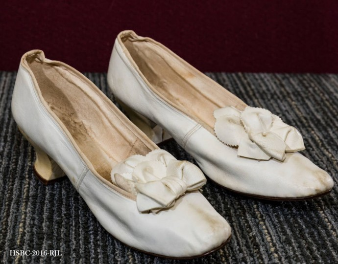 "Pair of leather and cotton offwhite shoes; marked ""2/12/C."" Worn by Emma Hyde Baldwin at her marriage to James Henry Quinby, on October 21, 1891. Gift of Gilbert & Carter Quinby, Virginia DeFriest. (Photo from the Baltimore Historical Society via Enoch Pratt Library)"