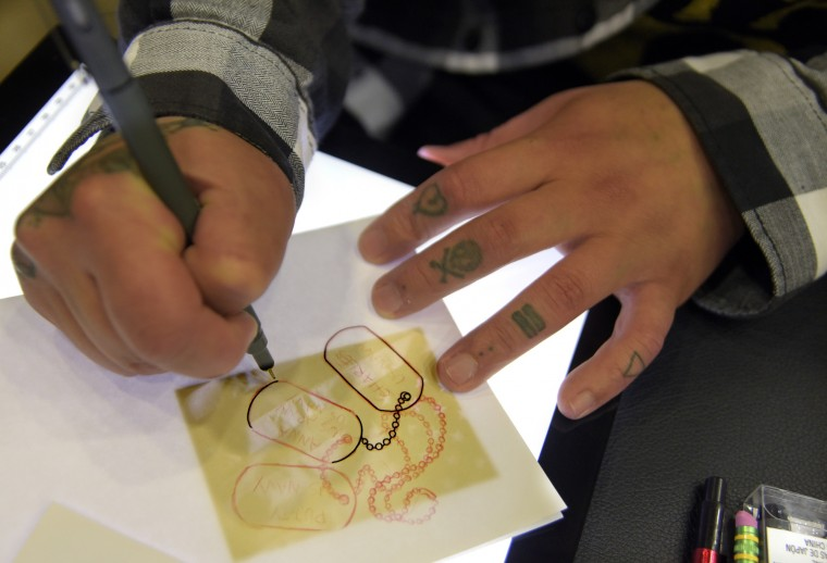 Nicky Hennerez from Canton, MD makes a template for a tattoo. He works as a tattoo artist in Crofton, MD.  (Algerina Perna/Baltimore Sun)