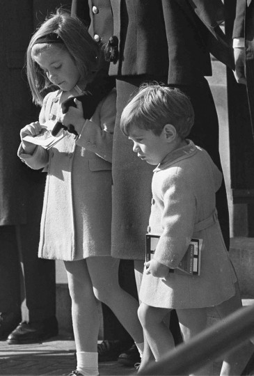 Caroline Kennedy and her brother, John Jr., accompany their mother, Jacqueline Kennedy, down the steps of Washington's St. Matthew's Roman Catholic Church after the funeral Mass for their father, assassinated President John F. Kennedy November 25, 1963, John Jr.'s third birthday. (AP Photo)