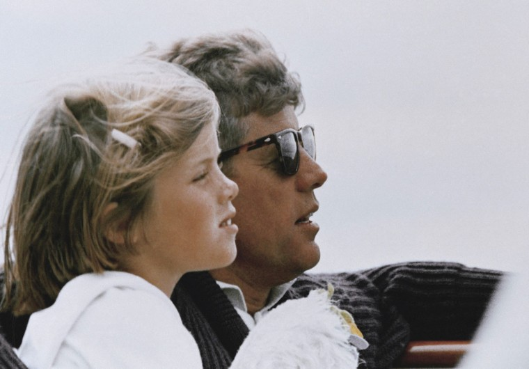 """In this 1962 file photo, President John F. Kennedy and his daughter, Caroline, sail off Hyannis Port, Mass. Caroline Kennedy said in a video released by the JFK Library on May 25, 2017, that she thought about her father and """"missed him every day of my life."""" The 100th anniversary of JFK's birth is Monday, May 29, 2017. (AP Photo, File)"""