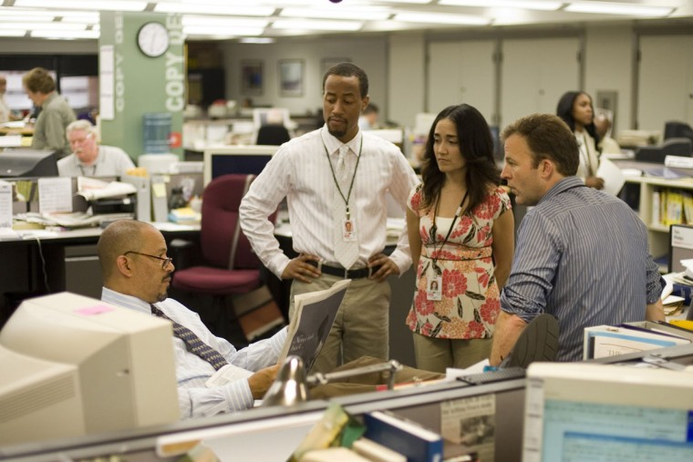 "In this photo released by HBO, (from left) actors Clark Johnson, Brandon Young, Michelle Paress, and Tom McCarthy in a scene from ""The Wire."" For its fifth and final season, ""The Wire"" ventured into a replica newsroom of The Sun, Baltimore's newspaper of record, where executive producer and lead writer David Simon worked for 13 years as a police reporter before he took a buyout in 1995. (AP Photo/Paul Schiraldi, HBO)"