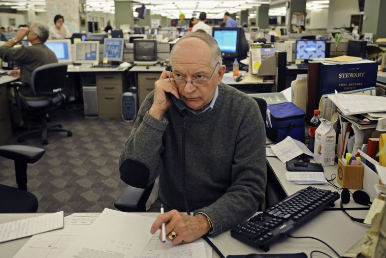 "Baltimore Sun crime reporter Richard Irwin wrote the ""police blotter"" for Baltimore City and County for 30 years, even before he started working for The Sun. Irwin is pictured calling area police departments in the Baltimore Sun newsroom. (Kenneth K. Lam/Baltimore Sun)"
