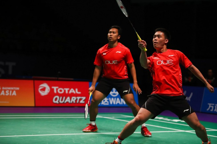 Terry Hee Yong Kai (R) of Singapore hits a return during the men's doubles Sudirman Cup match with partner Danny Bawa Chrisnanta against Vietnam's Do Tuan Duc and Pham Hong Nam at the Gold Coast Sports Centre on May 26, 2017. (Patrick Hamilton/AFP/Getty Images)