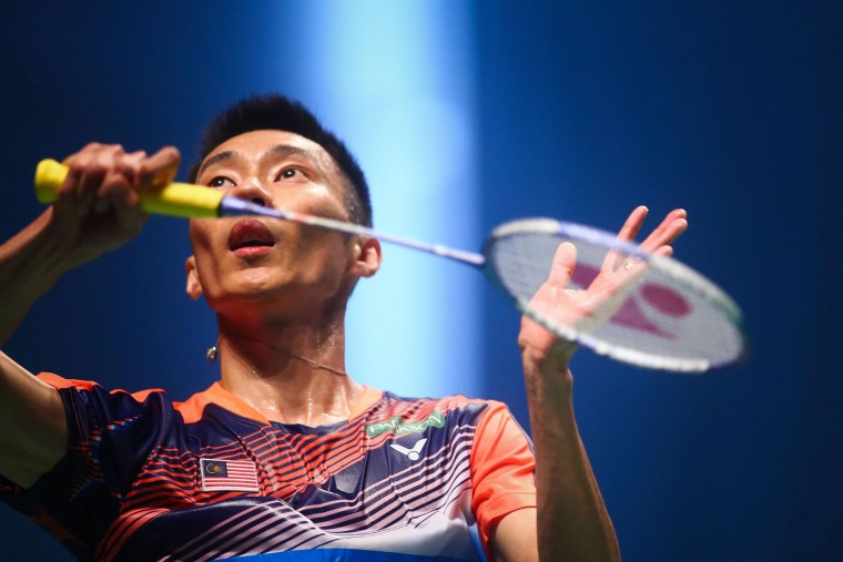 Lee Chong Wei of Malaysia hits a return against Japan's Kenta Nishimoto during their men's singles Sudirman Cup badminton match at the Gold Coast Sports Centre on May 26, 2017. (Patrick Hamilton/AFP/Getty Images)