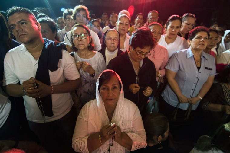 Pilgrims in Colombia pray during the celebration of the centenary of the appearance of Our Lady of Fatima in Portugal. (LUIS ROBAYO/AFP/Getty Images)