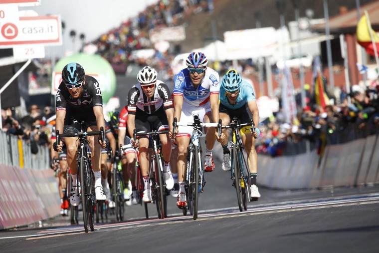Great Britain's Geraint Thomas (L) of team Sky and France's Thibaut Pinot of team FDJ cross the finish line of the 4th stage of the 100th Giro d'Italia, Tour of Italy, cycling race from Cefalu to Etna volcano, on May 9, 2017 in Sicily. Slovenian Jan Polanc conquered the prestigious Giro d'Italia fourth stage to Mount Etna on Tuesday as Luxembourg's Bob Jungels took the race leader's pink jersey. (Luk Benies/AFP/Getty Images)