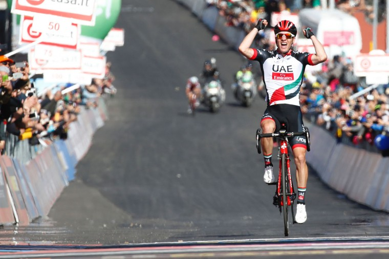 Slovenia's Jan Polanc of team UAE Emirates celebrates as he crosses the finish line to win the 4th stage of the 100th Giro d'Italia, Tour of Italy, cycling race from Cefalu to Etna volcano, on May 9, 2017 in Sicily. (Luk Benies/AFP/Getty Images)