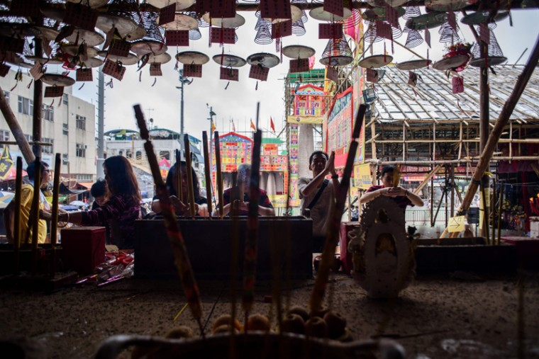 Devotees pray in a temple during the annual Cheung Chau bun festival in Hong Kong on May 3, 2017.(ANTHONY WALLACE/AFP/Getty Images)