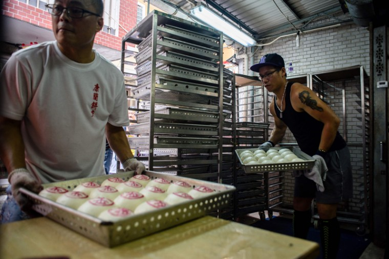 Bakers prepare during the annual Cheung Chau bun festival. (ANTHONY WALLACE/AFP/Getty Images)