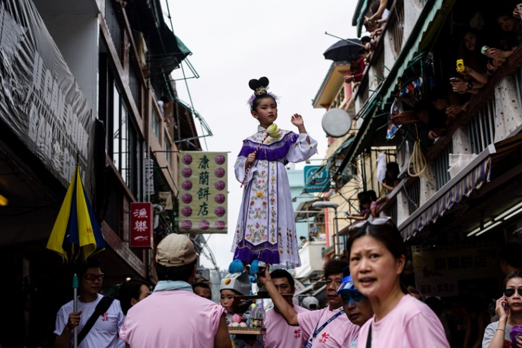 A young girl dressed as a deity takes part in a parade during the annual Cheung Chau Bun Festival in Hong Kong on May 3, 2017. (ANTHONY WALLACE/AFP/Getty Images)