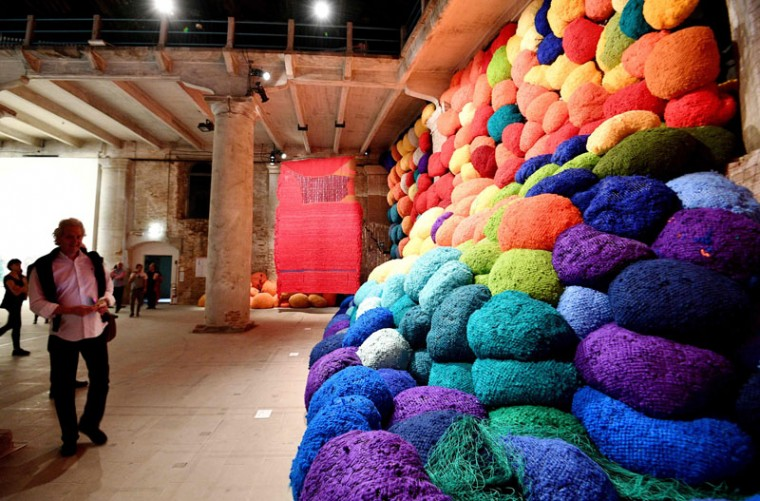 "The artwork ""Escalade Beyond Chromatic Lands"" by U.S. artist Sheila Hicks, on May 10, 2017 in Venice during the press preview of the 57th International Art Exhibition Biennale. The exhibition, titled ""Viva Arte Viva"" is curated by Christine Macel and will be open to the public from May 13 to November 26, 2017 at the Giardini and Arsenale venues. (VINCENZO PINTO/AFP/Getty Images)"