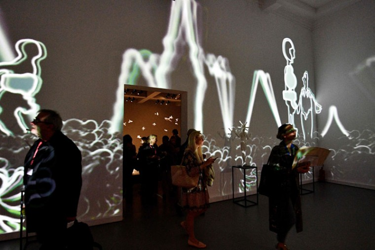 "Visitors admire ""Theatrum Orbis"" by Russian artist Grisha Bruskin. (VINCENZO PINTO/AFP/Getty Images)"