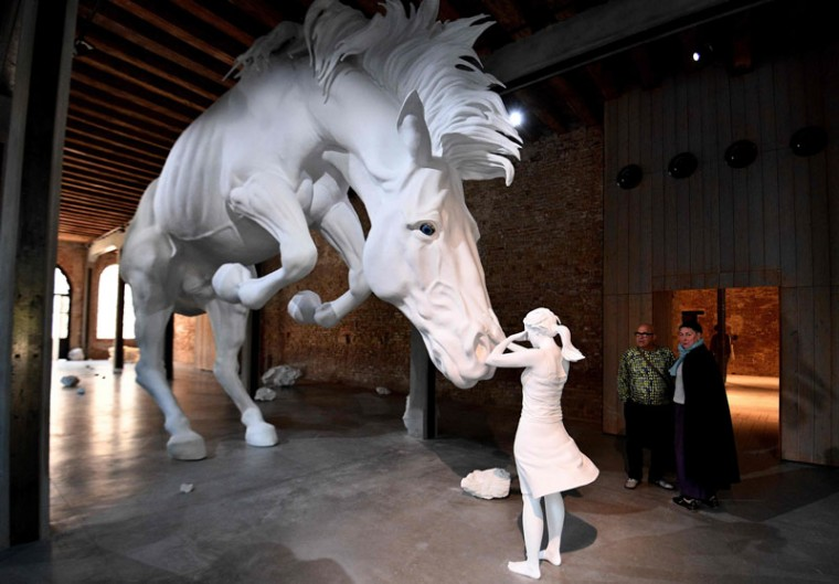 "Visitors admire ""The horse problem"" by Argentinian artist Claudia Fontes. (VINCENZO PINTO/AFP/Getty Images)"