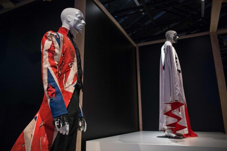 "Mannequins sport costumes of British pop icon David Bowie during the exhibition ""David Bowie is"" at the Museum of the Design of Barcelona, on May 24, 2017. (Josep Lago/AFP/Getty Images)"