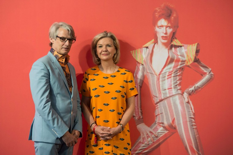 "English co-curators Geoffrey Marsh (L) and Victoria Broackes pose during a photocall for the exhibition ""David Bowie is"" at the Museum of the Design of Barcelona, on May 24, 2017. (Josep Lago/AFP/Getty Images)"
