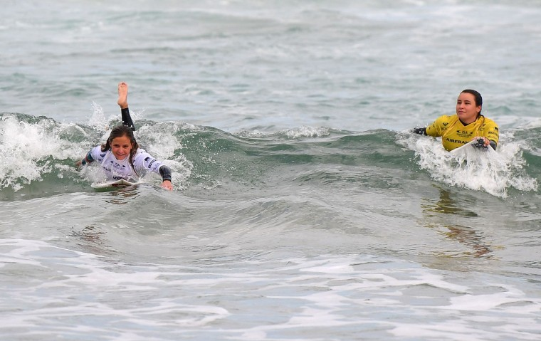 France's Pauline Ado (L), next to France's Johanne Lefay, reacts after winning the 2017 ISA World Surfing Games on May 22, 2027 in Biarritz, southwestern France. France's Pauline Ado scored the best finish of the final on the Grande Plage Beach, ahead of France's Johanne Defay and Costa Rican Leilani McGonagle. (Franck Fife/AFP/Getty Images)