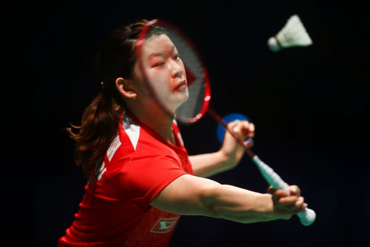 Ayaka Takahashi of Japan hits a return during the women's doubles Sudirman Cup match with partner Misaki Matsutomo against Vivian Hoo and Woon Khe Wei of Malaysia at the Gold Coast Sports Centre on May 26, 2017. (Patrick Hamilton/AFP/Getty Images)