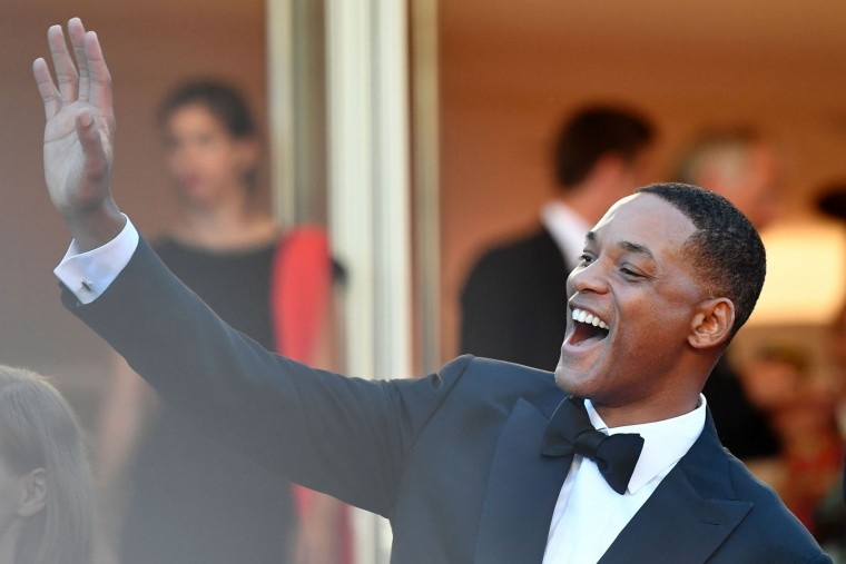 US actor and member of the Feature Film jury Will Smith waves as he arrives on May 17, 2017 for the screening of the film 'Ismael's Ghosts' (Les Fantomes d'Ismael) during the opening ceremony of the 70th edition of the Cannes Film Festival in Cannes, southern France. (Alberto Pizzoli/AFP/Getty Images)