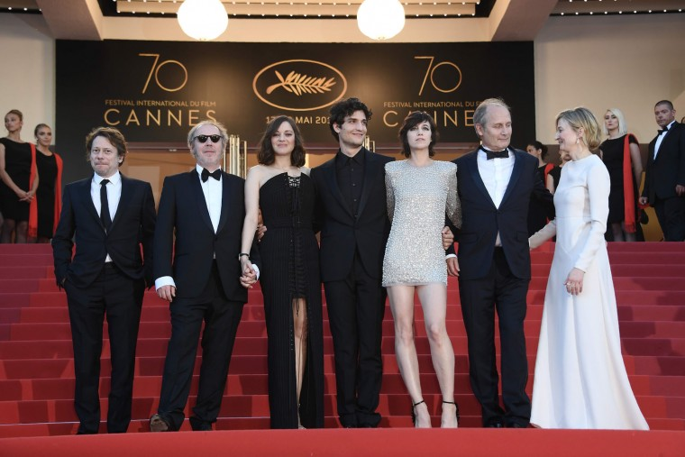 (From L) French actor Mathieu Amalric, French director Arnaud Desplechin, French actress Marion Cotillard, French actor Louis Garrel, French actress Charlotte Gainsbour, French actor Hippolyte Girardot, and Italian actress Alba Rohrwacher, pose as they arrive on May 17, 2017 for the screening of their film 'Ismael's Ghosts' (Les Fantomes d'Ismael) during the opening ceremony of the 70th edition of the Cannes Film Festival in Cannes, southern France. (Anne-Christine Poujoulat/AFP/Getty Images)