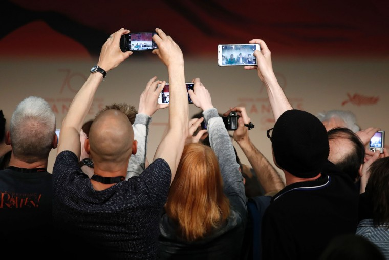 Journalists take photos of US actress Julianne Moore and US director Todd Haynes arriving to attend on May 18, 2017 a press conference for the film 'Wonderstruck' at the 70th edition of the Cannes Film Festival in Cannes, southern France. (Laurent Emmanuel/AFP/Getty Images)