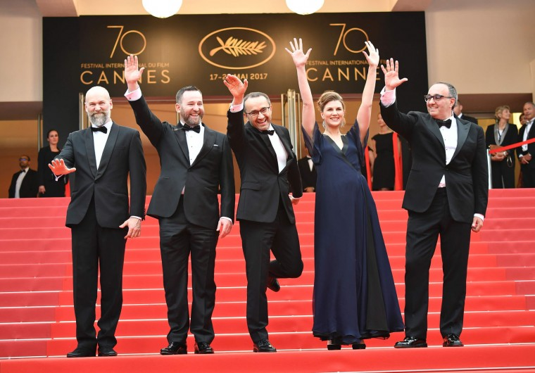 (From L) Russian cinematographer Mikhail Krichman, Russian actor Alexey Rozin, Russian director Andrey Zvyagintsev, Russian actress Maryana Spivak and Ukrainian producer Alexander Rodnyansky wave as they arrive on May 18, 2017 for the screening of their film 'Loveless' (Nelyubov) at the 70th edition of the Cannes Film Festival in Cannes, southern France. (Alberto Pizzoli/AFP/Getty Images)