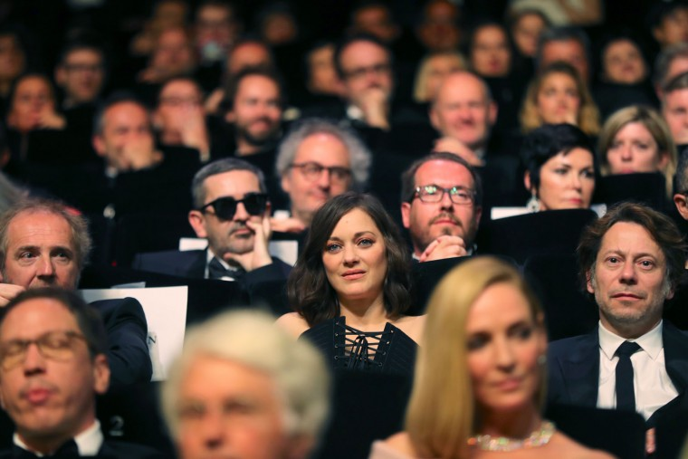 French actress Marion Cotillard (C), French actor Mathieu Amalric (R) and French director Arnaud Desplechin attend on May 17, 2017 the opening ceremony of the 70th edition of the Cannes Film Festival in Cannes, southern France. (Valery Hache/AFP/Getty Images)