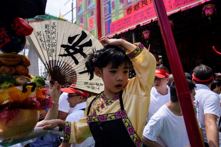 A young girl dressed as a deity takes part in a parade during the annual Cheung Chau Bun Festival. (ANTHONY WALLACE/AFP/Getty Images)