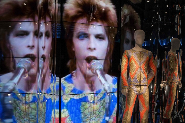 "A mannequin sports a costume of British pop icon David Bowie during the exhibition ""David Bowie is"" at the Museum of the Design of Barcelona, on May 24, 2017. (Josep Lago/AFP/Getty Images)"