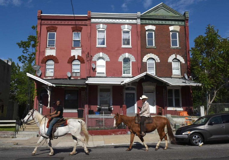 Philadelphia horsemen John Morris (hat) and Chris Coger go for a evening ride in the streets of Philadelphia on May 16, 2017. (TIMOTHY A. CLARY/AFP/Getty Images)