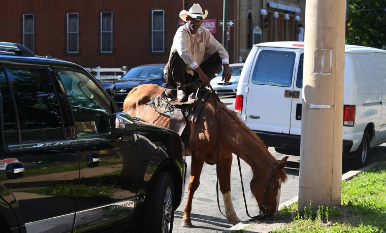 Philadelphia horsemen John Morris goes for a evening ride in the streets of Philadelphia on May 16, 2017. (TIMOTHY A. CLARY/AFP/Getty Images)