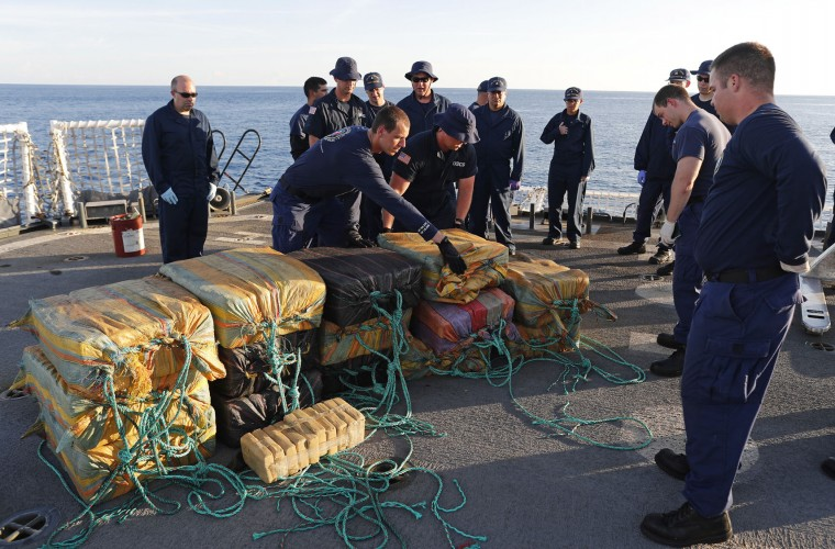 In this Feb. 23, 2017 photo, the crew from the U.S. Coast Guard cutter Stratton gather bales of cocaine that were seized from a small fishing boat. Four men were arrested caught smuggling some 700 kilos in the Pacific Ocean, hundreds of miles south of the Guatemala-El Salvador border. The Coast Guard set a record in 2016, seizing more than 240 tons of cocaine, however, that same year, the amount of land devoted to coca cultivation in Colombia climbed 18 percent. That is more coca production than at any time since the U.S. in 1999 began investing billions in an anti-narcotics strategy known as Plan Colombia. (AP Photo/Dario Lopez-Mills)