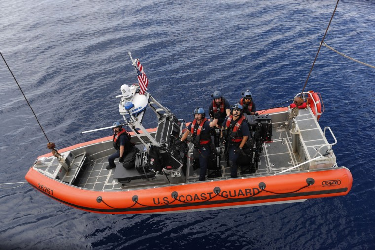 In this Feb. 23, 2017 photo, a U.S. Coast Guard law enforcement team is lowered on a small boat from the USCG cutter Stratton after a target of interest was sighted in the Pacific Ocean several hundred miles south of the Guatemala-El Salvador border. One of the Coast Guard's main missions is to intercept vessels hauling cocaine bound for America's cities. It is a monumental task that has grown even larger in the past few years because of a boom in coca production in Colombia. (AP Photo/Dario Lopez-Mills)