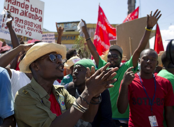 Workers chant anti-government slogans during a demonstration marking International Labor Day in Port-au-Prince, Haiti, Monday, May 1, 2017. (AP Photo/Dieu Nalio Chery)