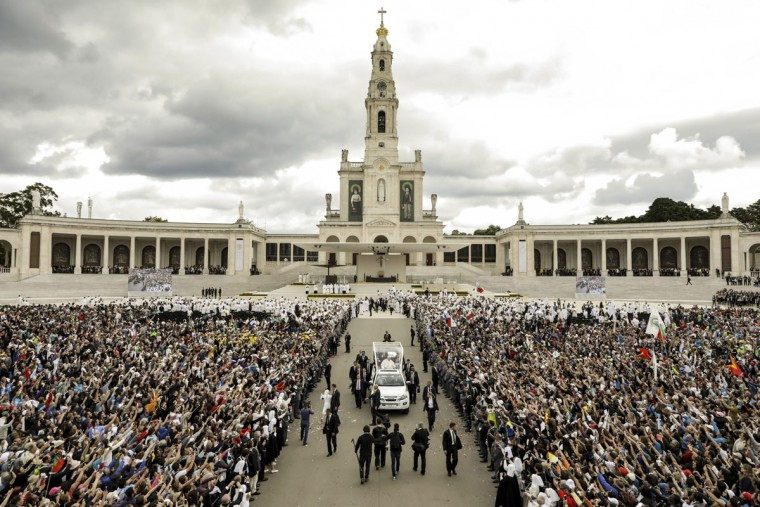 Pope Francis leaves at the end of a Mass where he canonized shepherd children Jacinta and Francisco Marto at the Sanctuary of Our Lady of Fatima May 13, 2017, in Fatima, Portugal. (Paulo Novais/Pool Photo via AP)