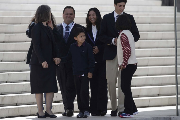 Lucas Baptista, center, attends a Mass celebrated by Pope Francis at the Sanctuary of Our Lady of Fatima in Portugal. Lucas' medically inexplicable healing was the miracle needed for the Marto siblings to be declared saints. The boy had fallen 21 feet from a window in 2013 and suffered such severe head trauma that his doctors said he would be severely mentally disabled or in a vegetative state if he survived. The boy survived and has no signs of after-effects. (AP Photo/Alessandra Tarantino)