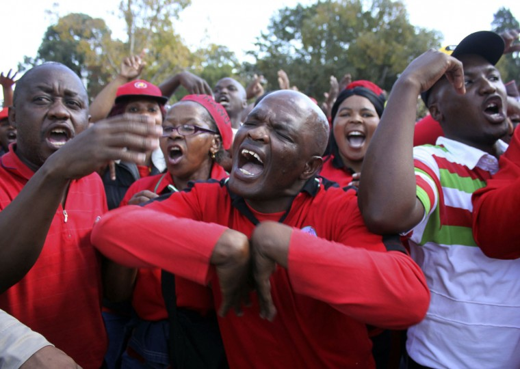 Workers attend a May Day rally in Bloemfontein, South Africa, Monday, May 1, 2017. South African President Jacob Zuma was jeered by labor unionists and his speech was cancelled after scuffles broke out between his supporters and workers chanting for him to step down at the rally. (AP Photo/Khothatso Mokone)