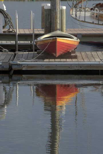 A rowing skiff sit on a floating dock at Chesapeake Bay Maritime Museum on the Miles River at Navy Point. (Algerina Perna/Baltimore Sun)