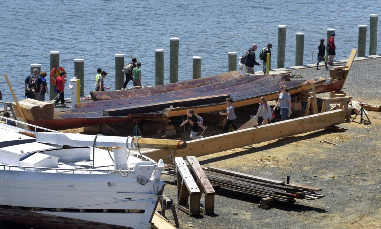 Third graders from Fruitland Intermediate School (Wicomico County) visit the working boatyard at the Chesapeake Bay Maritime Museum. At right right is a new log hull shipwrights are building for the historic 1889 bugeye Edna E. Lockwood at left. A bugeye is a hybrid of three boats used for oyster dredging on the Chesapeake Bay. (Algerina Perna/Baltimore Sun)