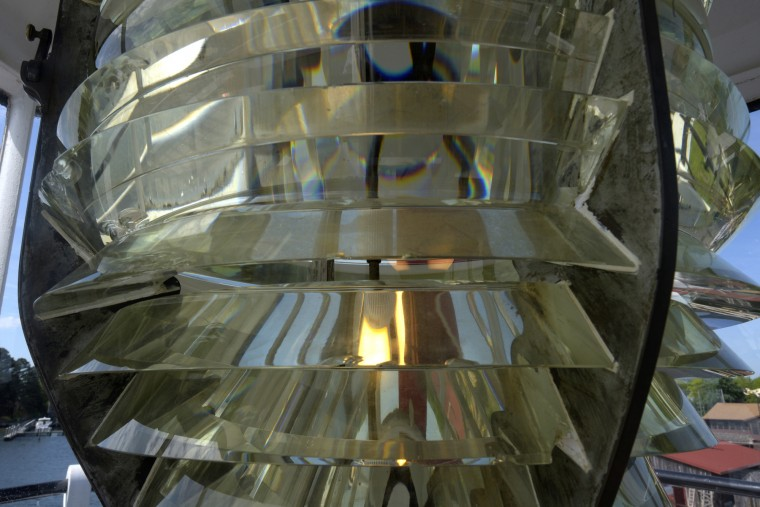 The fresnel lens in the Lantern Room of the Hooper Straight Lighthouse shines on the Miles River and St. Michaels Harbor. (Algerina Perna/Baltimore Sun)
