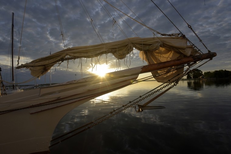 The bow of the H.M Krentz, an authentic working skipjack, pierces the dawn sky off the coast of St.Michaels where it's docked at Navy Point.  (Algerina Perna/Baltimore Sun)