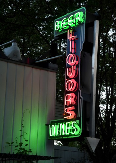 This vertical neon sign hung outside Curtis Bay Liquors on Pennington Avenue. (Amy Davis / Baltimore Sun)