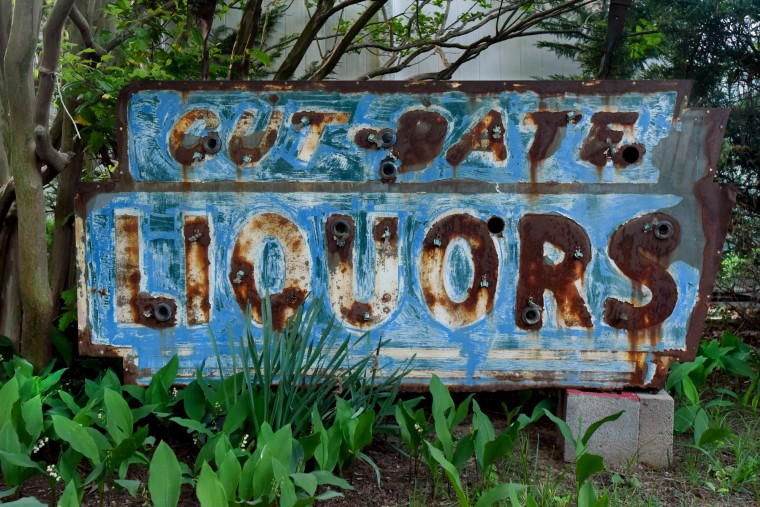 An example of a rescued sign bereft of its neon, with rust and faded paint, is from My Brother's Place, a package goods store on Eastern Boulevard near Dundalk Avenue. (Amy Davis / Baltimore Sun)