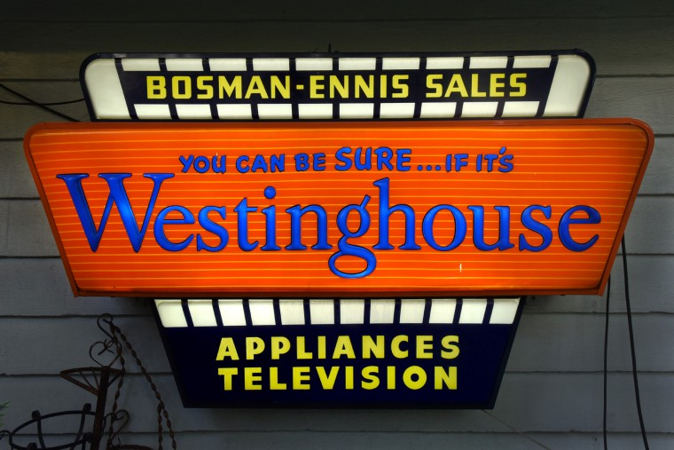 An example of a backlit fluorescent sign, from Bosman-Ennis Appliances in downtown Dundalk. These 1950s space-age plexiglas signs are rare because they are very brittle. (Amy Davis / Baltimore Sun)