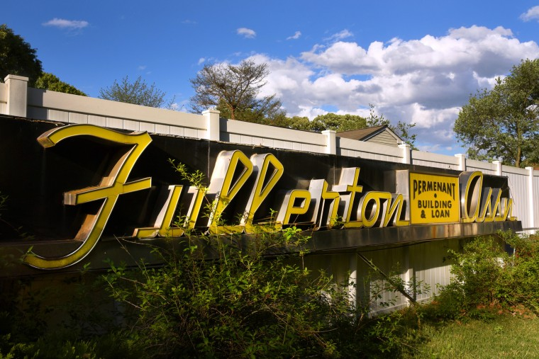 The Fullerton Permanent Building and Loan Association stainless steel sign by Belsinger Sign Works is 30-feet long. The unusual double-stroke script neon lettering was covered by yellow acrylic facing. It was built in 1955. (Amy Davis / Baltimore Sun)