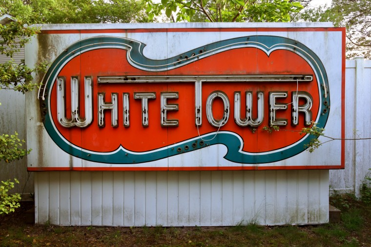 Neon was added to this White Tower sign in the mid-1950s, and it awaits rewiring by Norman James, who rescued it from the hamburger chain restaurant on Washington Boulevard and South Monroe Street  near Montgomery Ward. The eight-foot high porcelain enamel sign was built by Belsinger Sign Works. (Amy Davis / Baltimore Sun)
