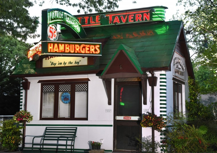 Norman James restored the salvaged neon signs from Little Tavern, and created a replica of the Laurel shop in the beloved hamburger chain to display the signs properly. (Amy Davis / Baltimore Sun)