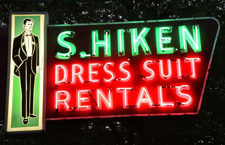 S. Hiken Dress Suit Rentals is from the flagship store for the formalwear chain, at Broadway and Baltimore Street. The 1954 combination sign represents the transition from neon on porcelain to backlit plastic in the 1950s. (Amy Davis / Baltimore Sun)