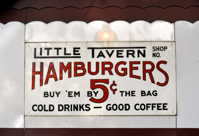 A pristine Little Tavern Hamburgers sign was found by Norman James at a sign company.  There is no shop number, indicating that it was never used. (Amy Davis / Baltimore Sun)