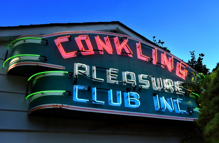 The 1930s Conkling Pleasure Club Inc. neon sign hung outside an old school Democratic club at Conkling and Dillon Streets. James got the sign, which still had its original neon units, when the building was torn down.   (Amy Davis / Baltimore Sun)