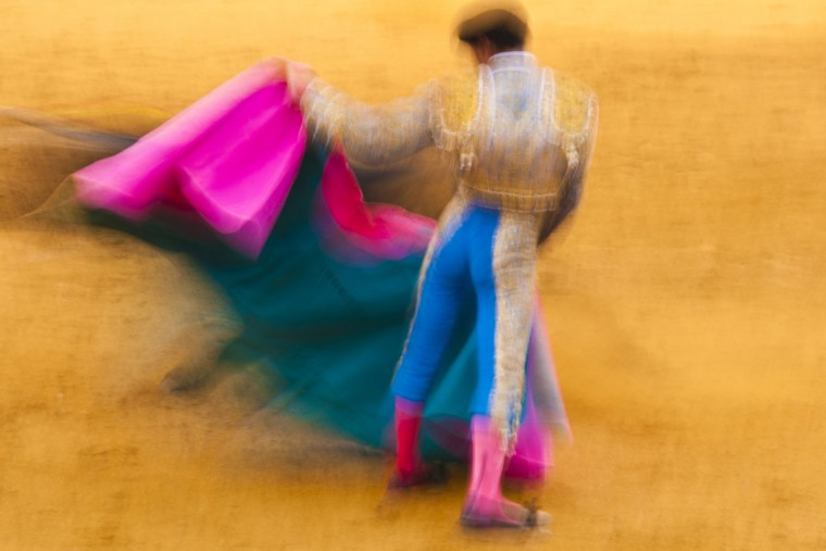 A slow shutter speed can make an image more fluid and active, such as in this photo by John Marks of a bullfighter in Marbella, Spain. (Famous photographer Ernst Haas used a similar technique for a Life magazine photo essay on bullfighting).